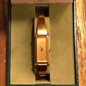 Gucci 1500 Gold Horsebit Bangle Watch